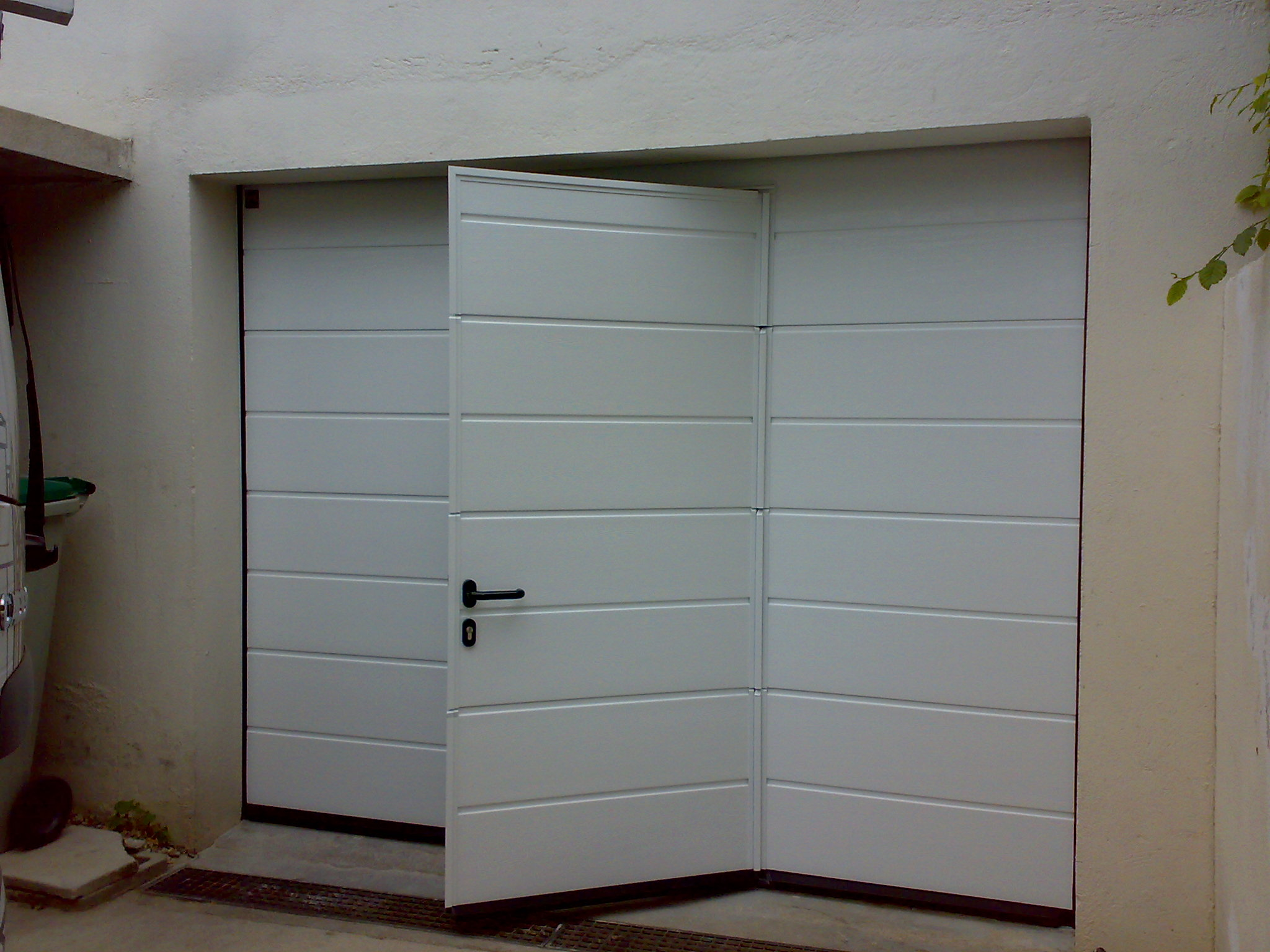 Portes de garage ab fermetures porte de garage for Porte de garage enroulable hormann prix